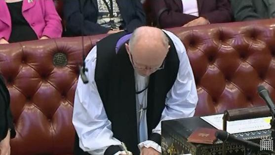 After swearing the Oath, the Bishop of Rochester signs the Roll and the Code of Conduct