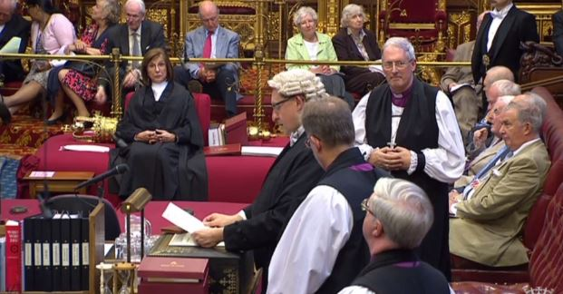 The Reading Clerk reads the Writ of Summons to the House, whilst the Bishop of Oxford stands with his two sponsors, the Bishops of Southwark and Norwich